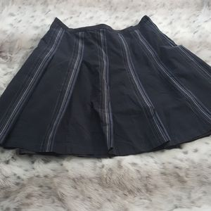 Navy blue pleated skirt with gray vertical stripes